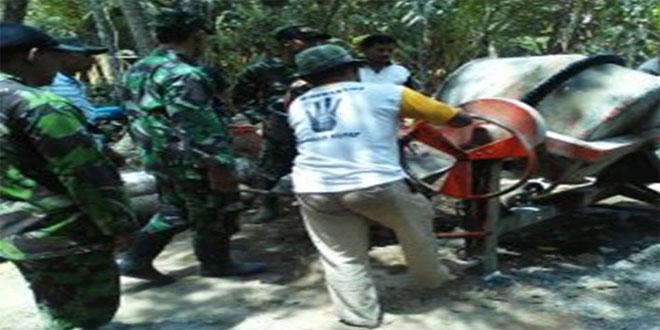 Koramil 06/Butuh Karya Bhakti Cor Blok Jalan Desa Lugu Kecamatan Butuh