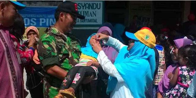 Babinsa Ramil 10/Moga Dampingi Camat Moga Pencanangan Pekan Imunisasi Nasional (PIN)